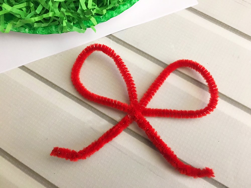 DIY Christmas Paper Wreath is a fun paper craft to do with the whole family. It's inexpensive to make and adds a festive touch to your holiday decor-glue pipe cleaner loops together to form a bow