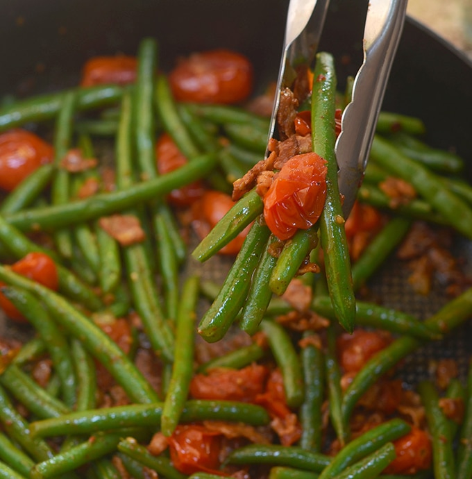 sauteed green beans, bacon and tomatoes in a skillet