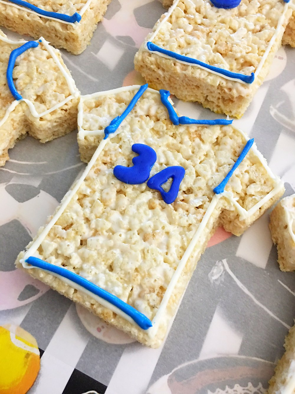 Sports Jersey Rice Krispies Treats are the perfect dessert or snack for a game day party. They're as much fun to make as they are to eat-draw details on the jerseys using blue frosting