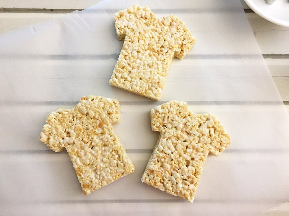 Sports Jersey Rice Krispies Treats are the perfect dessert or snack for a game day party. They're as much fun to make as they are to eat-Place cut Rice Krispies on a sheet of parchment paper