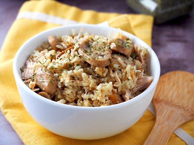 Pressure Cooker Chicken and Rice with Mushrooms in a white bowl