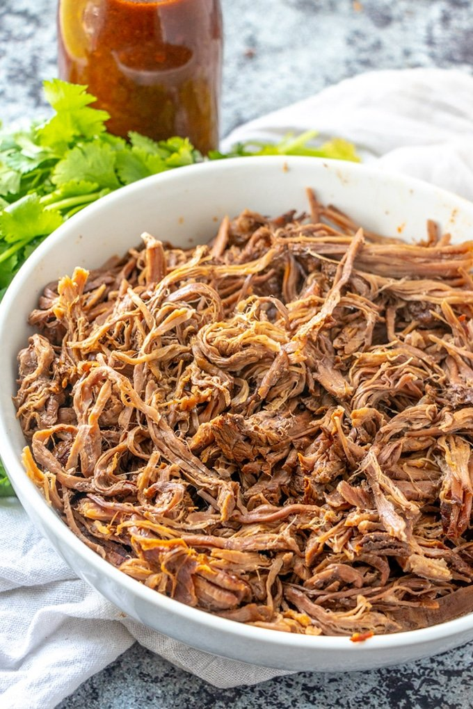 Slow Cooker Beef Barbacoa is made easy in the crockpot or Instant Pot.