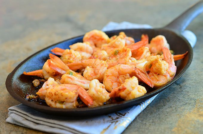 Spicy Garlic Shrimp with spicy, garlicky sauce is perfect for sopping up with crusty bread! This Spanish tapa, Gambas al Ajillo, has all the big, bold flavors you'll love in an appetizer or dinner meal.