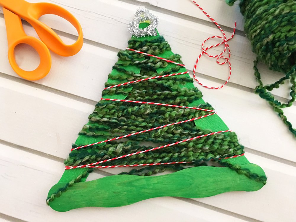 Yarn-Wrapped Christmas Tree Craft Stick Ornaments are a great holiday project for the whole family. They're so easy to make and a festive addition to your Christmas decor-wrap twine around craft stick tree and glue to secure