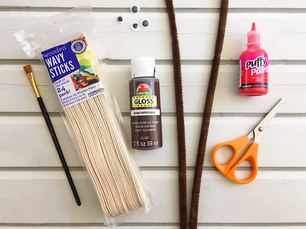Materials needed to make DIY craft stick ornaments