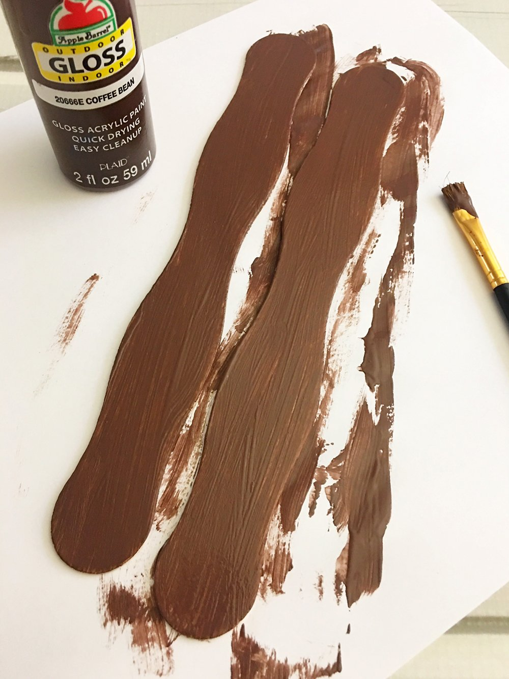 Paint the craft sticks brown to make the body of the reindeer