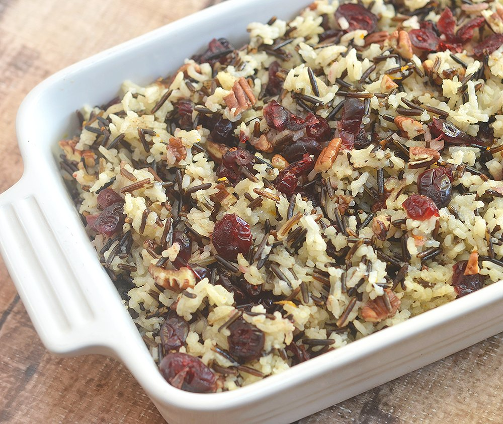 Cranberry and Pecan Wild Rice Casserole is the perfect Thanksgiving side dish or turkey stuffing! Delicious crunch, festive color, and Fall flavors!