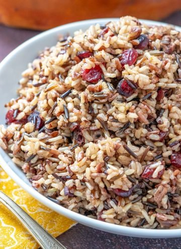 Cranberry Pecan Wild Rice Stuffing in a white serving bowl