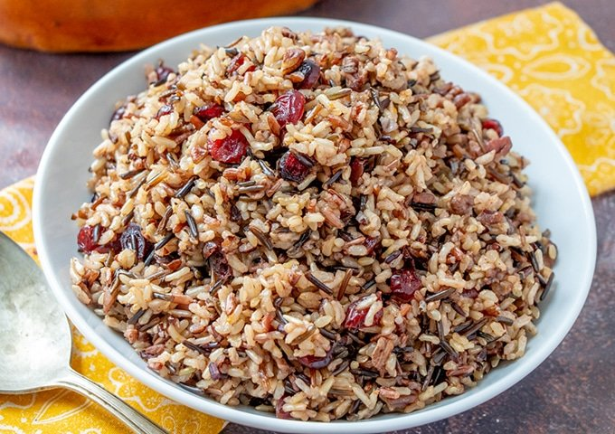 Wild Rice Stuffing with cranberries and pecans in a serving bowl