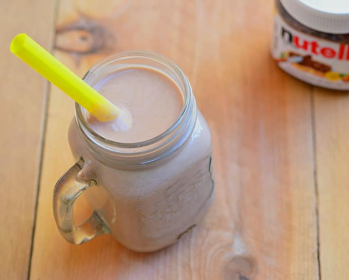 Nutella Banana Smoothie is rich, creamy and chocolatey! Perfect pick me up treat!