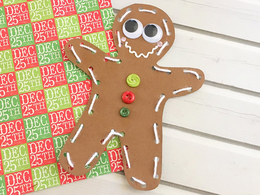 Homemade Card stock paper Gingerbread man ornaments are the perfect holiday project for little hands. Use as gift tags, tree ornaments or dinner placecards