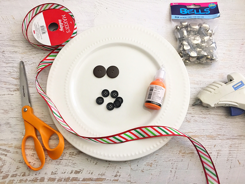 DIY Snowman Decorative Plate is an adorable addition to any Christmas decor! So easy and fun to make with simple supplies from the Dollar Store-materials