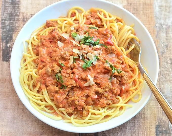 Spaghetti alla Vodka with Italian sausage on a serving plate