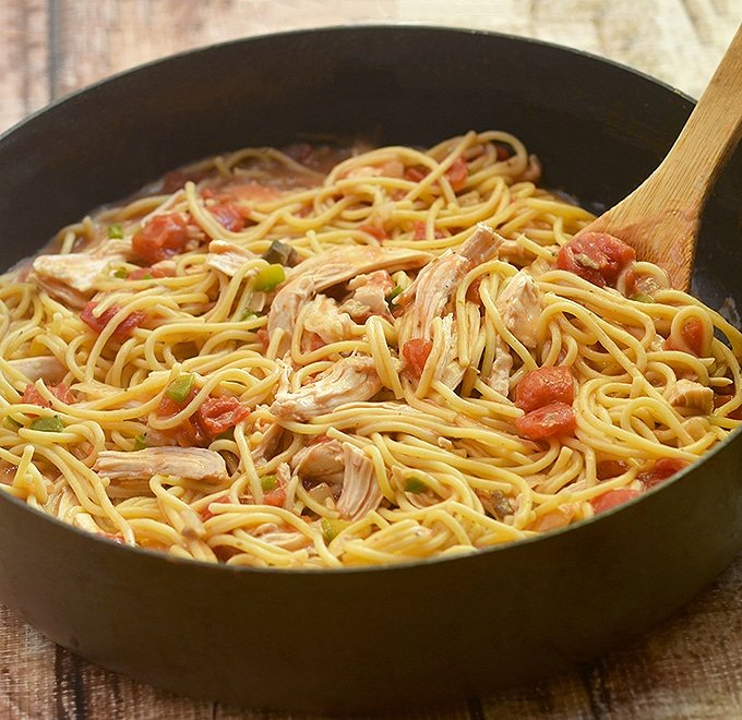 Chicken Spaghetti cooked in the skillet with moist chicken, spaghetti noodles and creamy tomato sauce