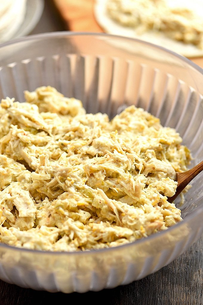 creamy chicken filling for chicken taquitos in large clear bowl