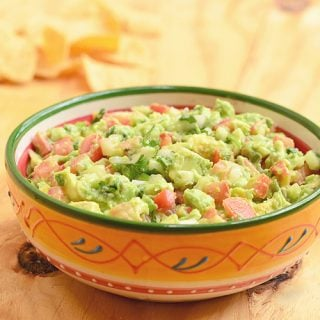 Easy Guacamole Dip is ready in minutes, packed with flavor and makes a great appetizer or side dish. Get the best tips on how to keep it fresh and green longer!