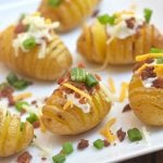 Mini Loaded Hasselback Potatoes turn baby yukon golds into a fun appetizer or side dish! Cut accordion-style, baked and then topped with sour cream, bacon, cheese, and green onions, they're absolutely addicting!