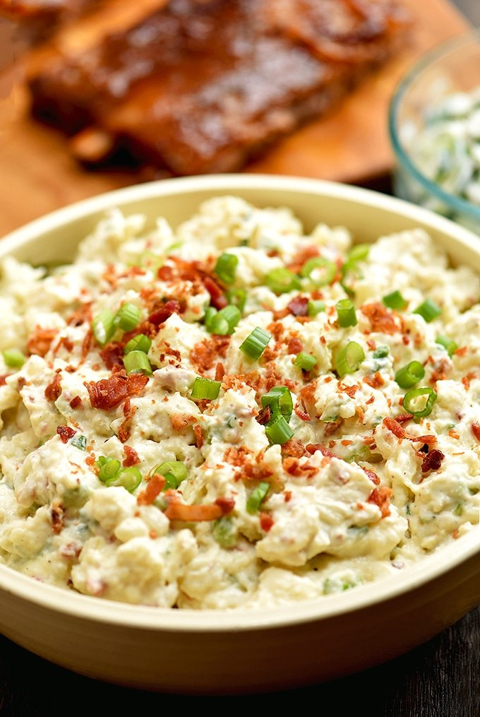 You'll love this loaded potato salad with bacon crumbles, chopped eggs, crisp celery and green onions!
