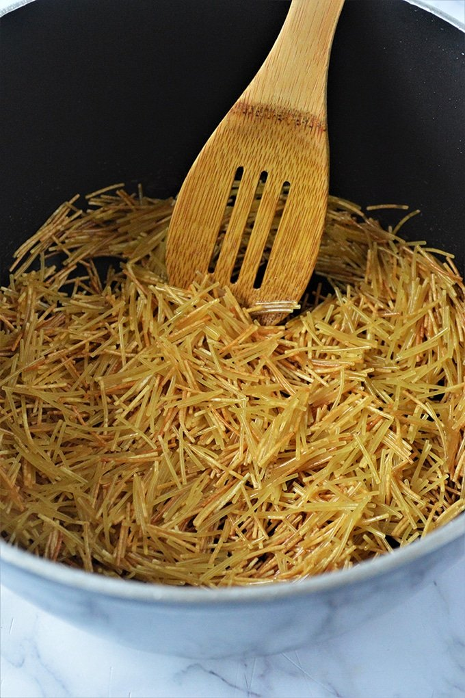 browning fideo noodles in a pan