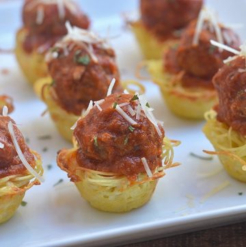 Mini Spaghetti Pie topped with marinara sauce and meatballs