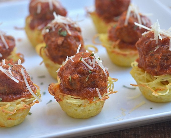 Mini Spaghetti Pie topped with marinara sauce and meatballs make a great appetizer for your next party!