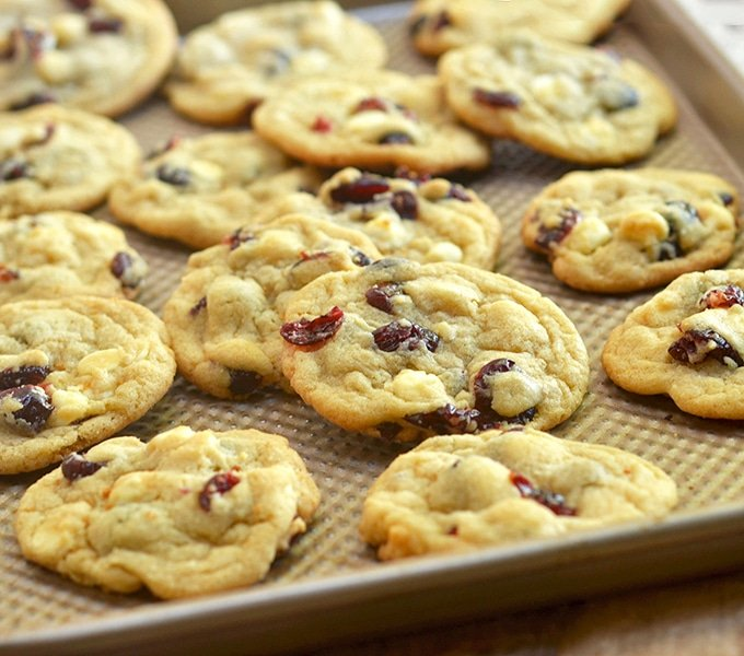 Cranberry white chocolate chip cookies on a baking sheet
