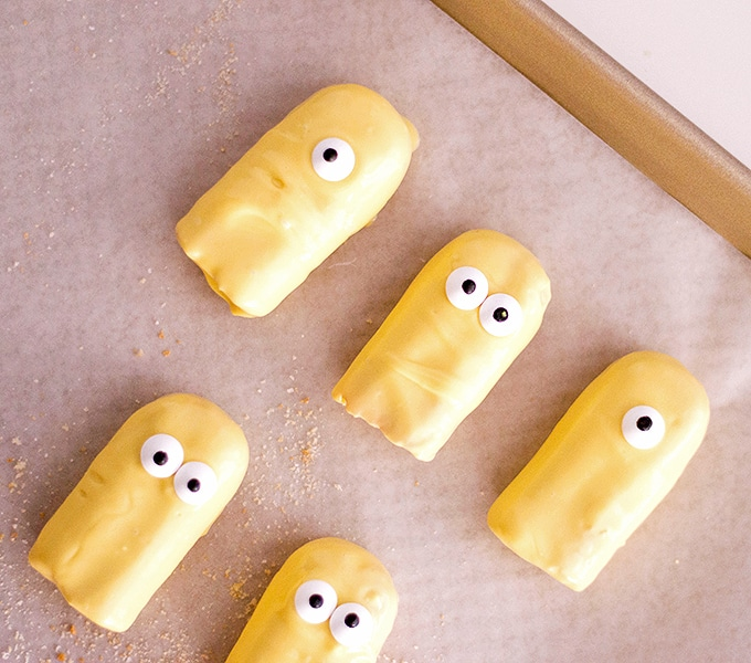 ladyfingers dipped in yellow coating to make Minion Cupcakes