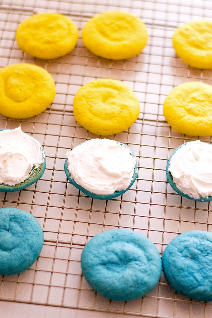 to make Minion whoopie pies, spread the buttercream on the blue whoopie cakes