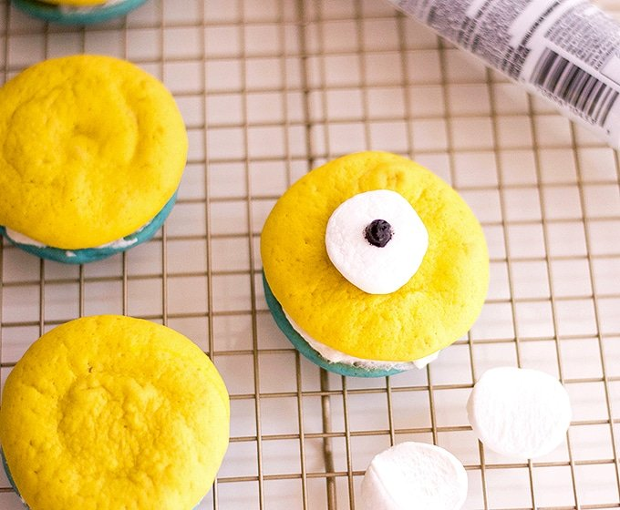 place the marshmallow as eyes using buttercream to glue on