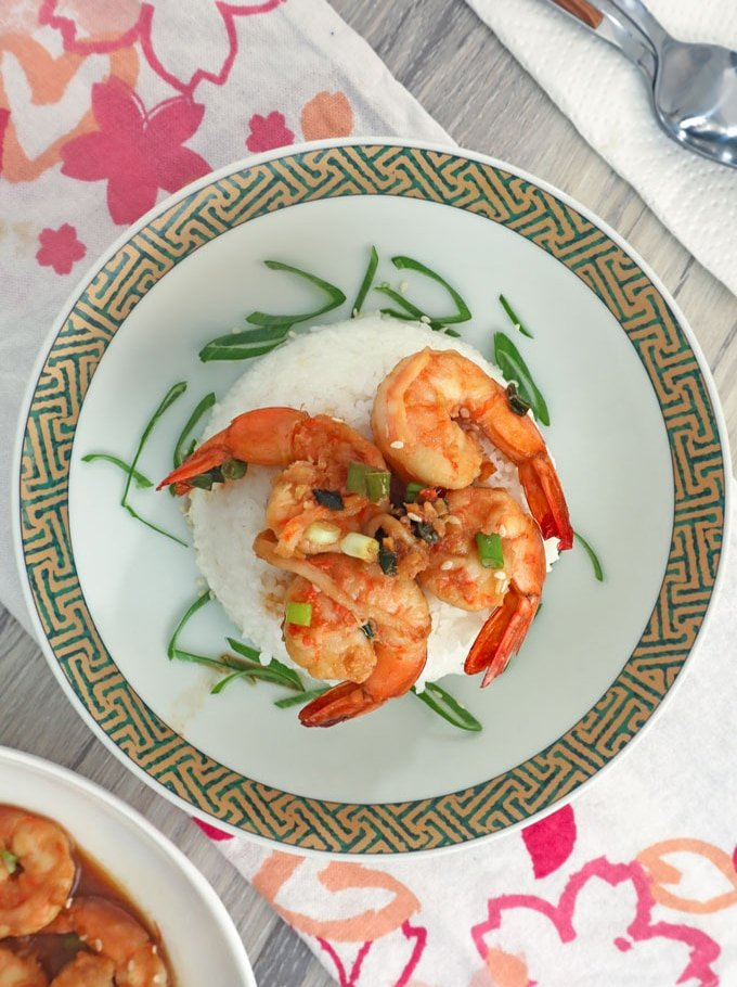 honey soy shrimp stir-fry over steamed rice on a plate