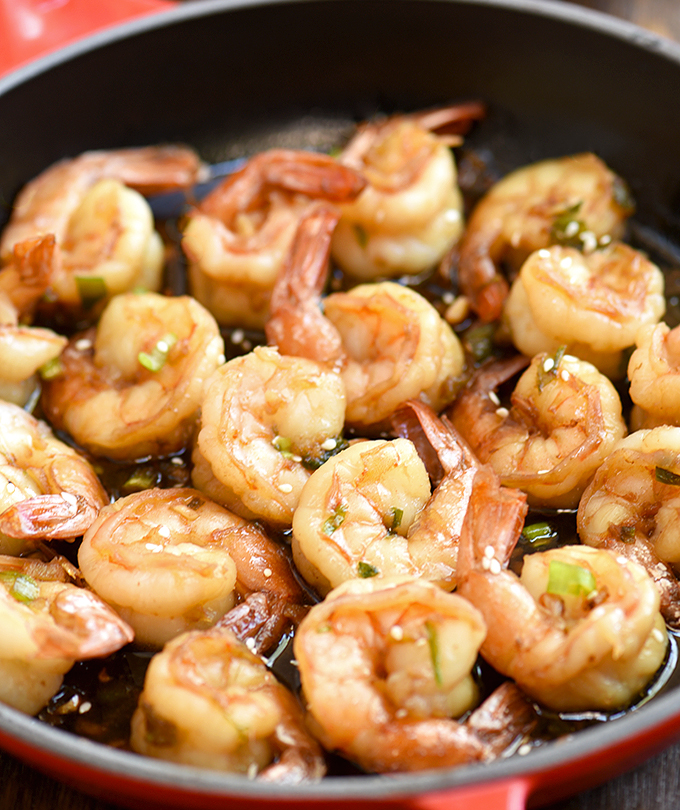 soy sauce shrimp stir-fry in a red skillet