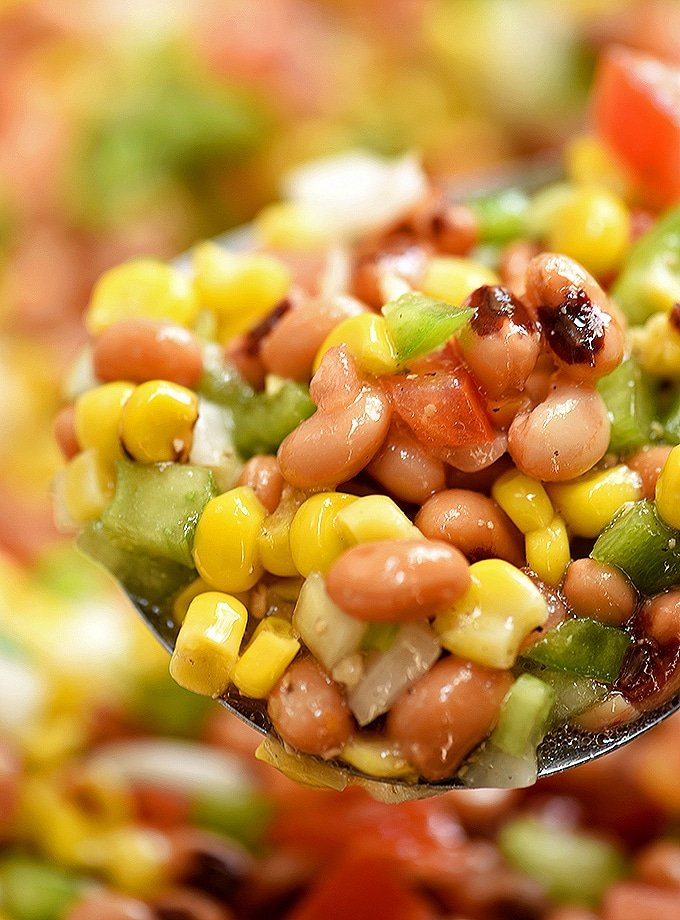 serving Texas caviar or cowboy caviar with a large spoon