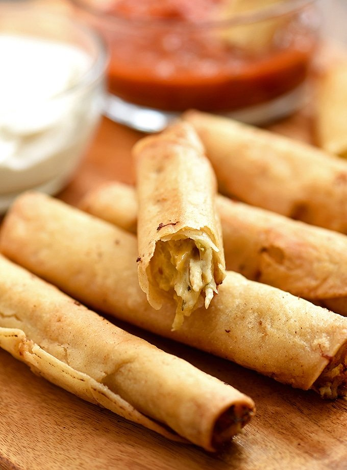 creamy chicken taquitos with shredded chicken, salsa verde, and cream cheese fried to golden perfection