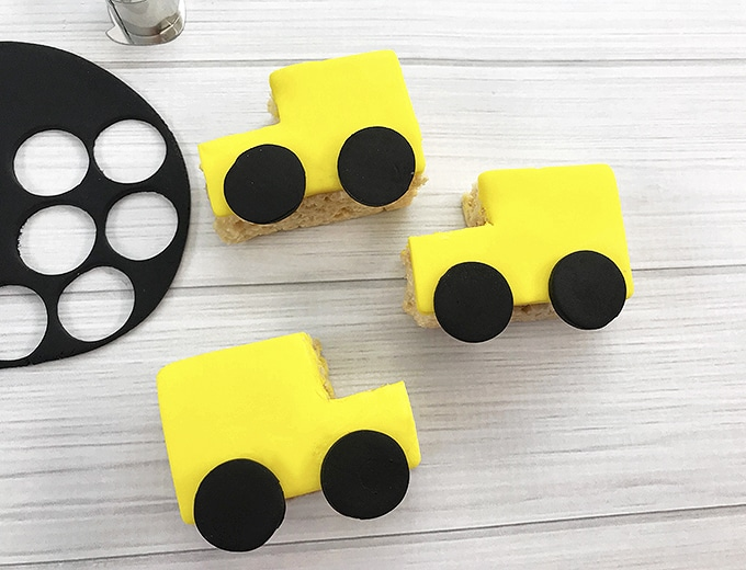small black fondant circles glued on yellow School bus rice krispies treats to resemble wheels