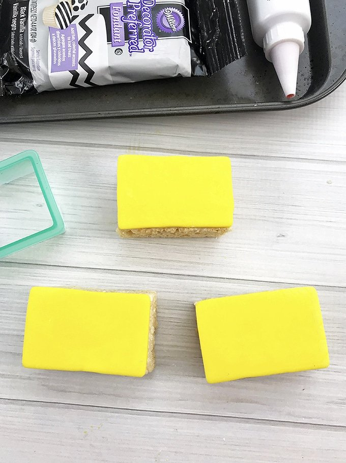 rice krispies treat bar covered with yellow fondant to make Back-to-school Rice Krispies treats