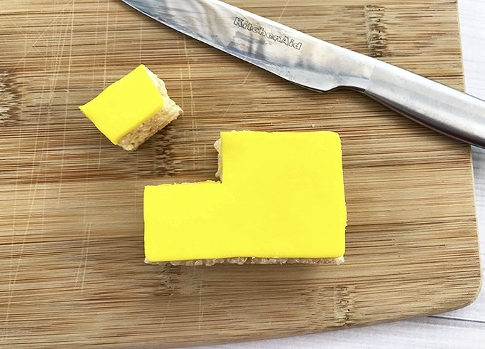 yellow fondant-covered Rice Krispies treats cut into school bus shape