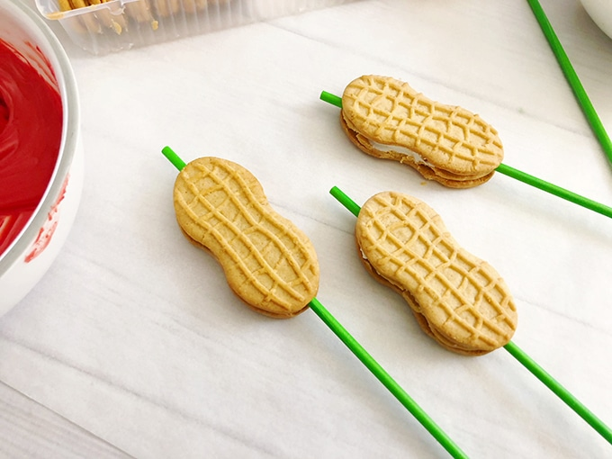 nutter butter cookies skewered with green lollipop sticks