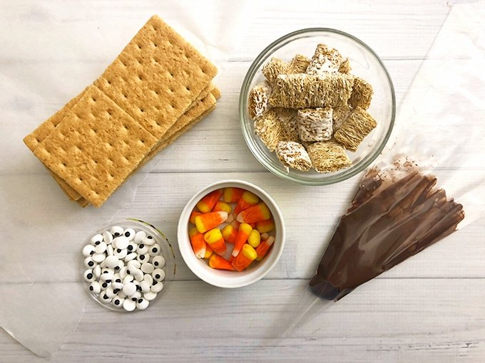 Scarecrow Graham Cracker supplies: graham crackers, candy eyes, candy corn, mini Wheaties and melted chocolate.