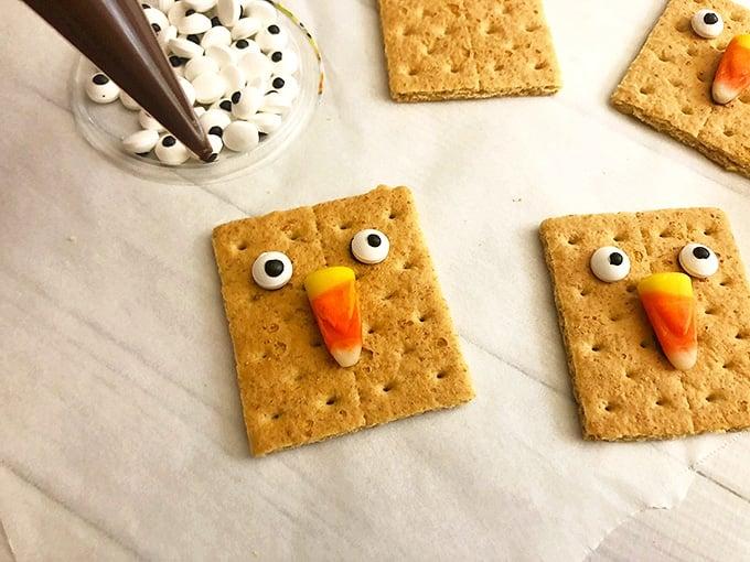 Scarecrow Graham Crackers need some eyes next!