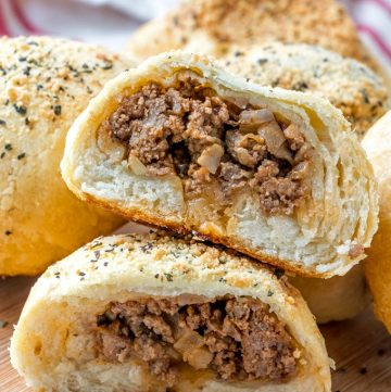 cut baked bread buns with sloppy joe filling