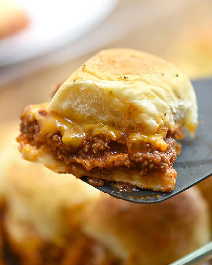 serving baked sloppy joe slider with a spatula