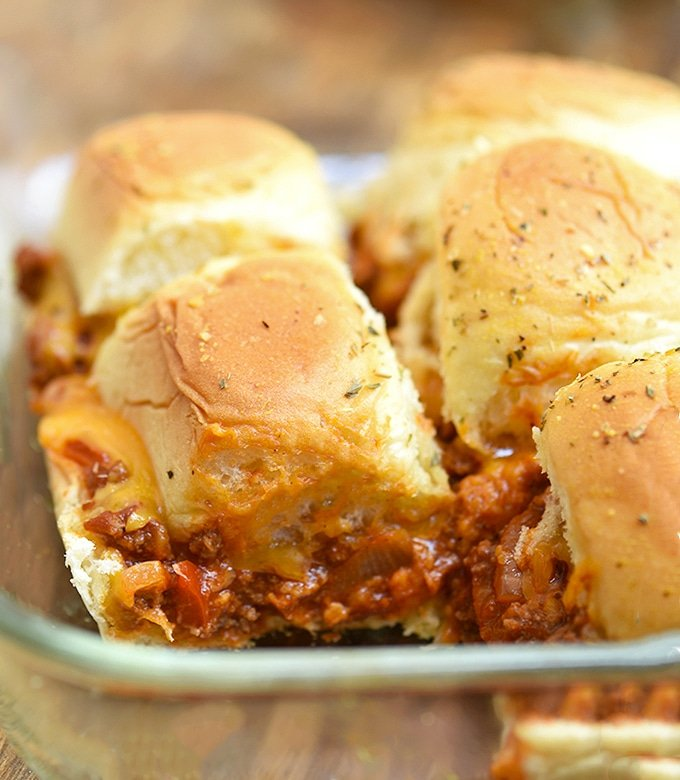 cheesy sloppy joe sliders baked in a glass casserole dish