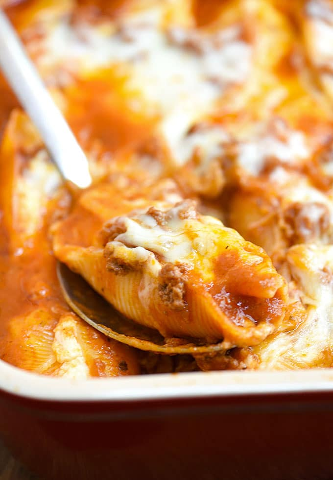 Stuffed Pasta Shells with Meat Sauce and cheese baked in casserole dish