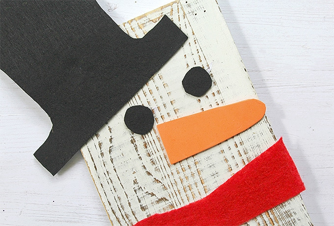 Upcycled Snowman Wooden Board Decor made with painted wood and craft felt