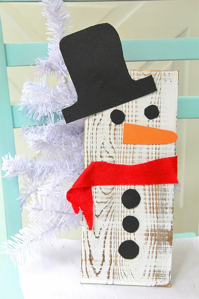 This easy DIY wooden snowman made with an upcycled wooden board is an adorable christmas craft