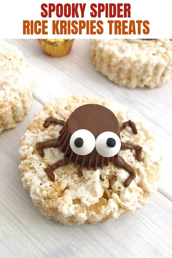 round rice krispies treats decorated with peanut butter cup spiders