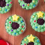 Christmas Wreath Cupcakes on a wood board