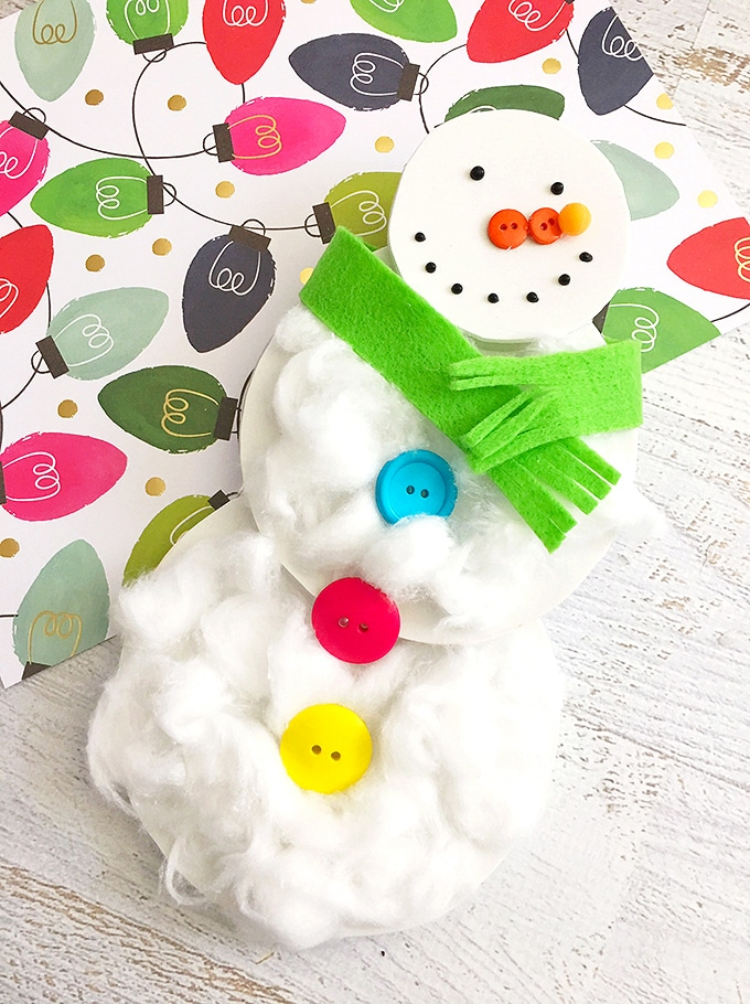 A cottonball snowman craft is the perfect way to spend a snow day with the kiddos