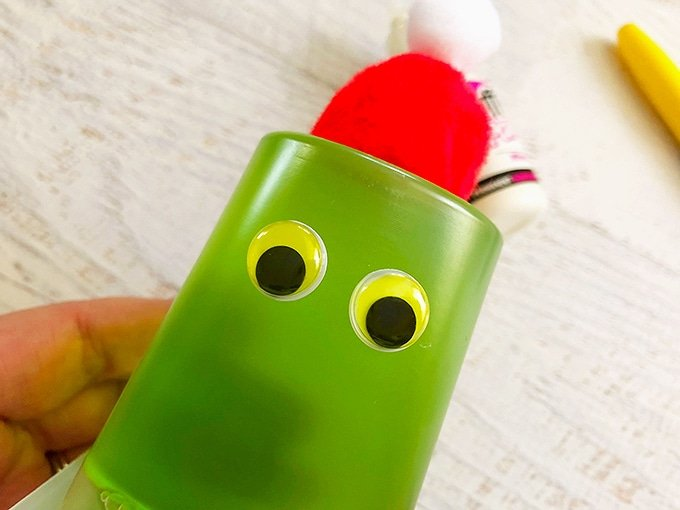 glue googly eyes on green jello cups to make Grinch snack cups