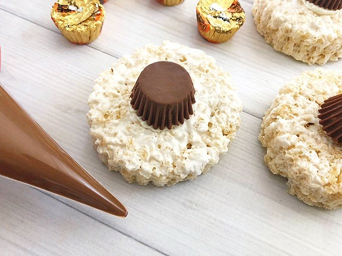 peanut butter cup placed on top of round rice krispies treats